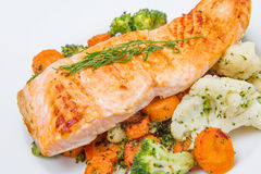Salmon fillet on a bed of broccoli, cauliflower and carrots Royalty Free Stock Photo