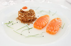 Salmon fillet with bread and caviar Royalty Free Stock Photos