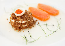 Salmon fillet with bread and caviar Stock Images
