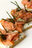 Salmon fillet on bread slice. With vegetables and cheese Stock Image