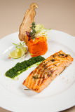 Salmon fillet with carrot puree Royalty Free Stock Photo