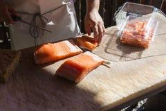 Salmon fillet. Chef preparing some salmon fillet royalty free stock image