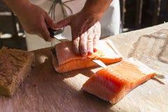 Salmon fillet. Chef preparing some salmon fillet royalty free stock photo