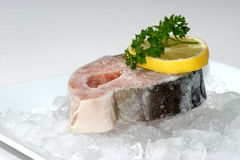 Salmon fillet on crushed ice with lemon Royalty Free Stock Images