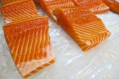 Salmon fillet, cut into pieces. Salmon fillet cutting into pieces Stock Photos
