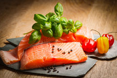 Salmon fillet on flat rocks. Ready to cook Royalty Free Stock Image