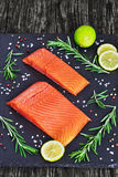 Salmon fillet with fresh rosemary, close-up Royalty Free Stock Photography