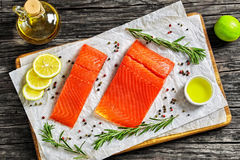 Salmon fillet with fresh rosemary on paper Stock Photo