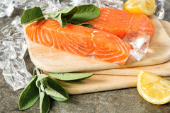 Salmon fillet with fresh sage herb, lemon and ice Stock Images