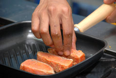 A Salmon fillet on a fried Stock Photos
