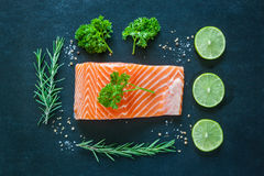Salmon fillet with garnish on blackboard Stock Photo