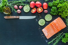 Salmon fillet with garnish ready to cook Royalty Free Stock Photography