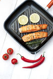 Salmon fillet on grill pan ready to cook stock image