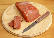 Salmon fillet with knife on cutting board, close-up Stock Photos