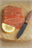 Salmon fillet with knife on cutting board Stock Photo