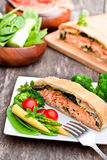 Salmon  fillet on leek and spinach  baked in puff pastry  Stock Images