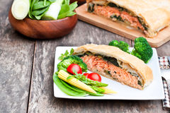 Salmon  fillet on leek and spinach  baked in puff pastry  Royalty Free Stock Photo