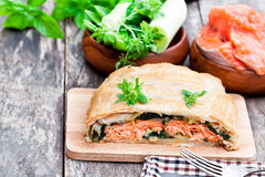 Salmon  fillet on leek and spinach  baked in puff pastry  Royalty Free Stock Photography