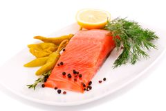 Salmon fillet. With lemon, dil, pepper on plate isolated on white background Stock Photography