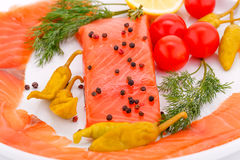 Salmon fillet. With lemon, dill, pepper on plate Stock Photography