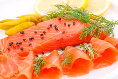 Salmon fillet. With lemon, dill, pepper on plate Royalty Free Stock Photography