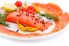 Salmon fillet. With lemon, dill, pepper on plate isolated on white background Stock Photography