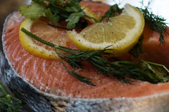 Salmon fillet with lemon and dill. Steak of salmon on foil food Royalty Free Stock Photo