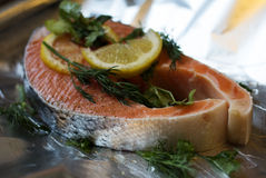 Salmon fillet with lemon and dill. Steak of salmon on foil food Stock Photo