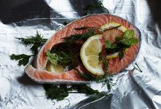 Salmon fillet with lemon and dill. Steak of salmon on foil food Stock Photos