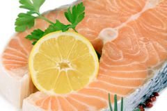 Salmon fillet with lemon. Isolated on a white background Stock Photo