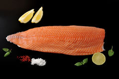 Salmon fillet with lemon lime and spices Royalty Free Stock Photography