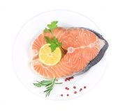 Salmon fillet with lemon and parsley. On a white plate Stock Photos