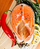 Salmon fillet with lemon. Salmon fillet with rosemary and lemon Royalty Free Stock Image