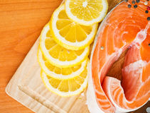 Salmon fillet with lemon. Salmon fillet with rosemary and lemon Stock Images