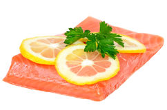 Salmon fillet and lemon slices. Isolated on white background Royalty Free Stock Photography
