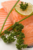 Salmon fillet with lime Stock Image