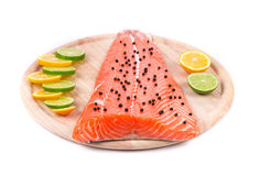 Salmon fillet with lime and oranges Royalty Free Stock Photography