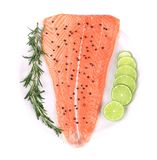 Salmon fillet with lime and rosemary. Isolated on a white background Stock Image