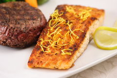 Salmon and fillet mignon. Garnished with lemon slices royalty free stock photo