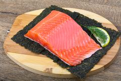 Salmon fillet. On nori background with dill and lemon royalty free stock photography