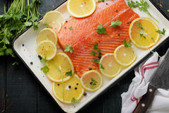 Salmon fillet with orange on baking dish Royalty Free Stock Photo