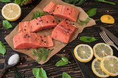 Salmon fillet on parchment paper Stock Photo