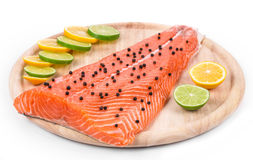 Salmon fillet with pepper and citrus. Royalty Free Stock Images