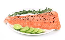 Salmon fillet with pepper on plate. Isolated on a white background Royalty Free Stock Photography