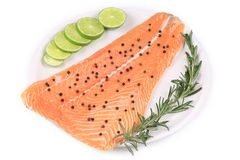 Salmon fillet with pepper and rosemary. On a white background Stock Images