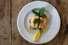 Salmon fillet, pesto and crushed potato plate from above royalty free stock photos