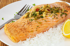 Salmon Fillet with Pine Nuts Royalty Free Stock Images