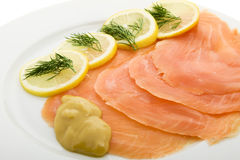 Salmon fillet on plates Royalty Free Stock Image