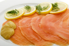 Salmon fillet on plates Stock Photos