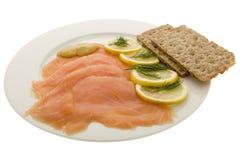 Salmon fillet on plates Stock Photos